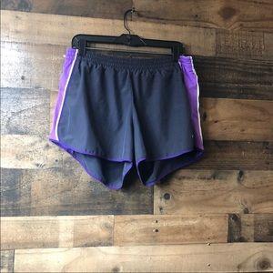 "Nike DriFit Purple & White Shorts. Inseam 4""."
